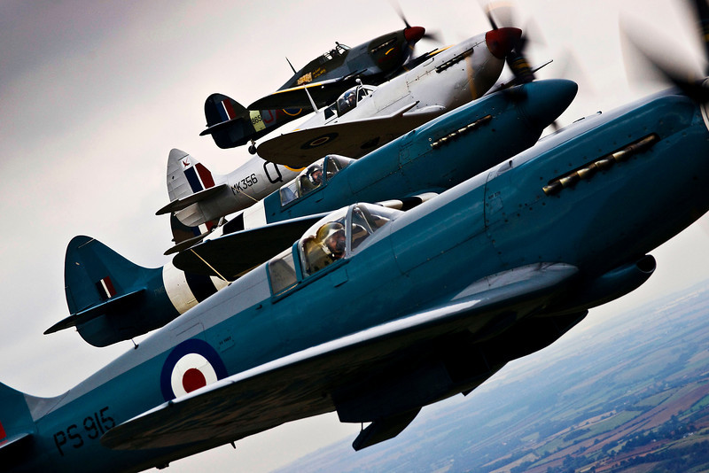 Spitfire and Hurricane aircraft from World War II come together over Lincolnshire, for the Lincolnshire Lancaster Association Day event held at RAF Coningsby.<br /> <br /> This image was a runner-up in the 2010 RAF Photographic Competition for SAC Sally Raimondo.