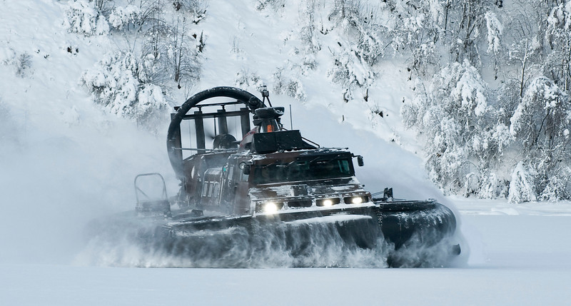 A Royal Marine Landing Craft Air Cushioned (Light Replacement), also known as LCAC(LR), is pictured operating in the frozen environment of Norway. <br /> <br /> This craft is operated by Royal Marines from 539 Assault Squadron based in Plymouth, Turnchaple. It is capable of carrying up to 16 Royal Marines plus their kit from ship to shore, at up to speeds of 50 Knots. It is equally adept on sea as well as ice, leaving no shore line unapproachable by the Royal Marines.