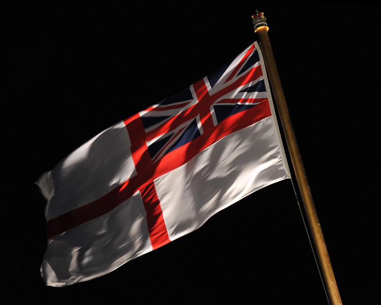 The White Ensign flies proudly from a Royal Navy warship.<br /> <br /> The ensign is traditionally flown from a staff at the stern of Royal Navy vessels whilst in harbour.