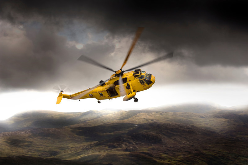 Air to air shot of a Search and Rescue (SAR) SeaKing helicopter from RAF Valley, during a training sortie in the Snowdon mountains of North Wales.