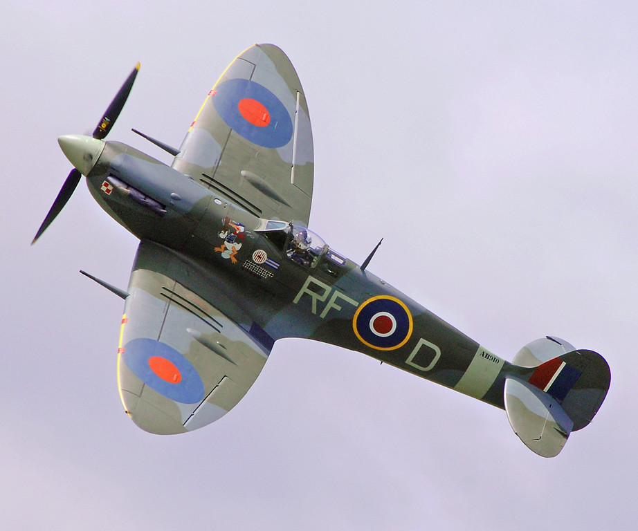 A Spitfire from the historic Battle of Britain Memorial Flight (BBMF) soars overhead.