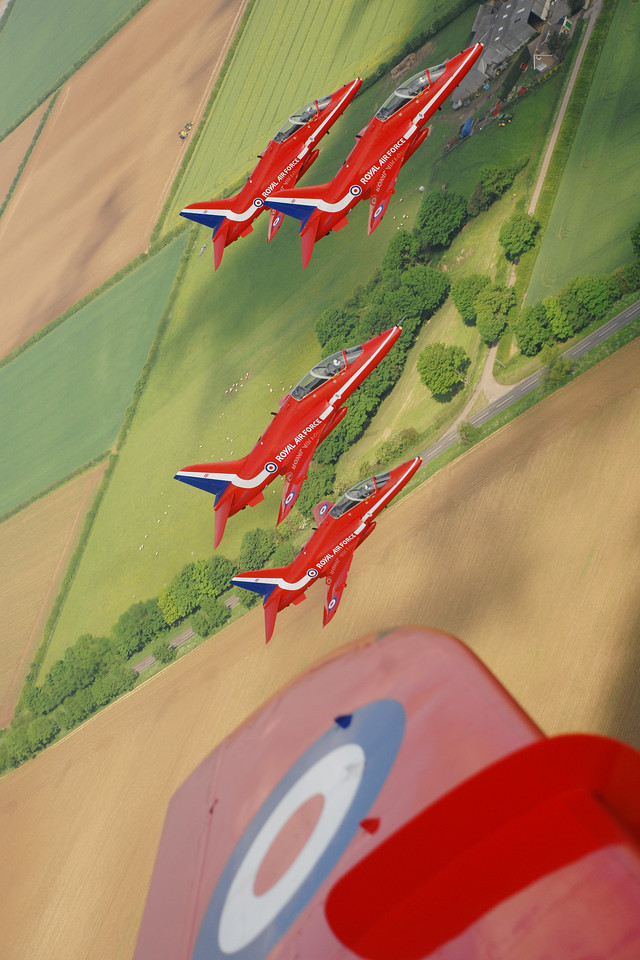 The Red Arrows practice a display over their home base of RAF Scampton in Lincolnshire.