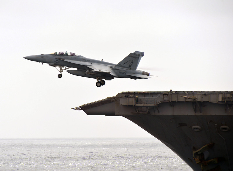 An F18 Super Hornet aircraft takes off from USS Enterprise.<br /> <br /> The American aircraft carrier was being accompanied during an exercise in the Middle by Royal Navy Type 45 destroyer HMS Diamond.<br /> <br /> <br /> <br /> <br /> <br /> <br /> <br /> On the 8th August 2012 US Aircraft Carrier USS Enterprise came to within 500 yards of HMS Diamond as the two ships operated alongside each other in the Middle East as part of Carrier strike Group 12 (CSG12)<br /> <br /> <br /> <br /> <br /> <br /> <br /> <br /> HMS Diamond is currently deployed in the Middle East where she is conducting operational duties