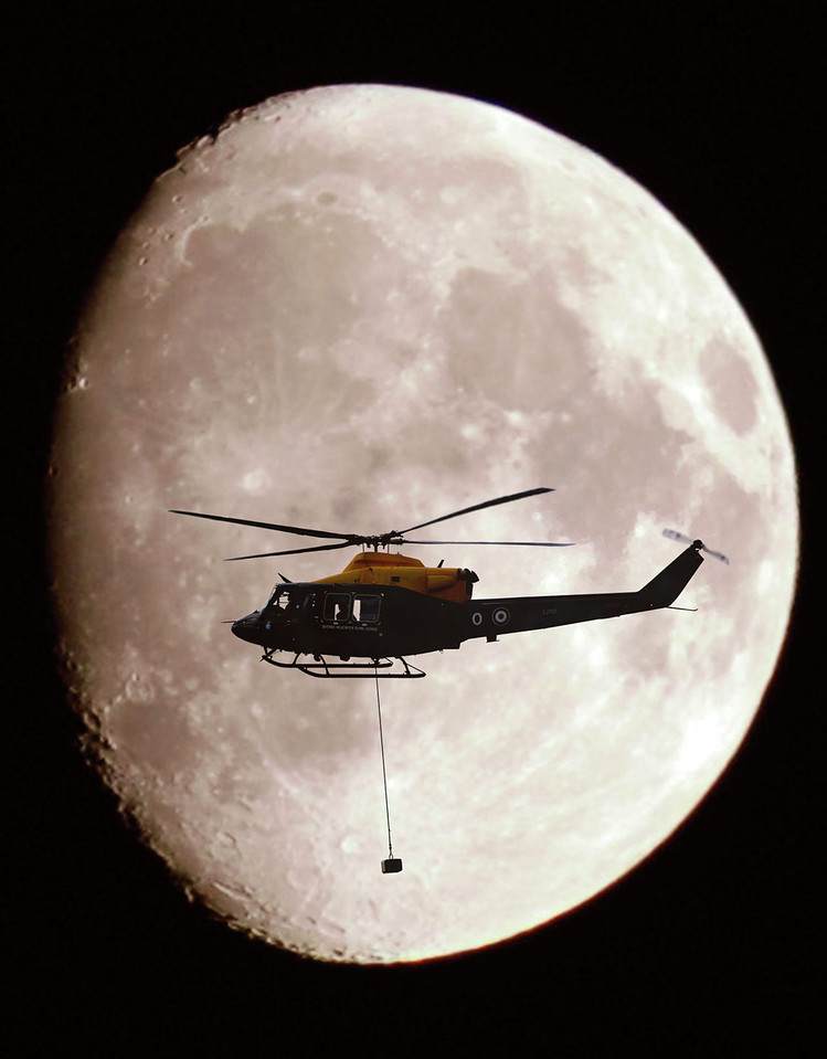 This image was submitted as part of the RAF Photographers Photographic Competition 2005.  Category F, Digital Manipulation.<br /> <br /> A Griffin HT1 Helicopter, with an underslung load, shown in silhouette against a full moon.