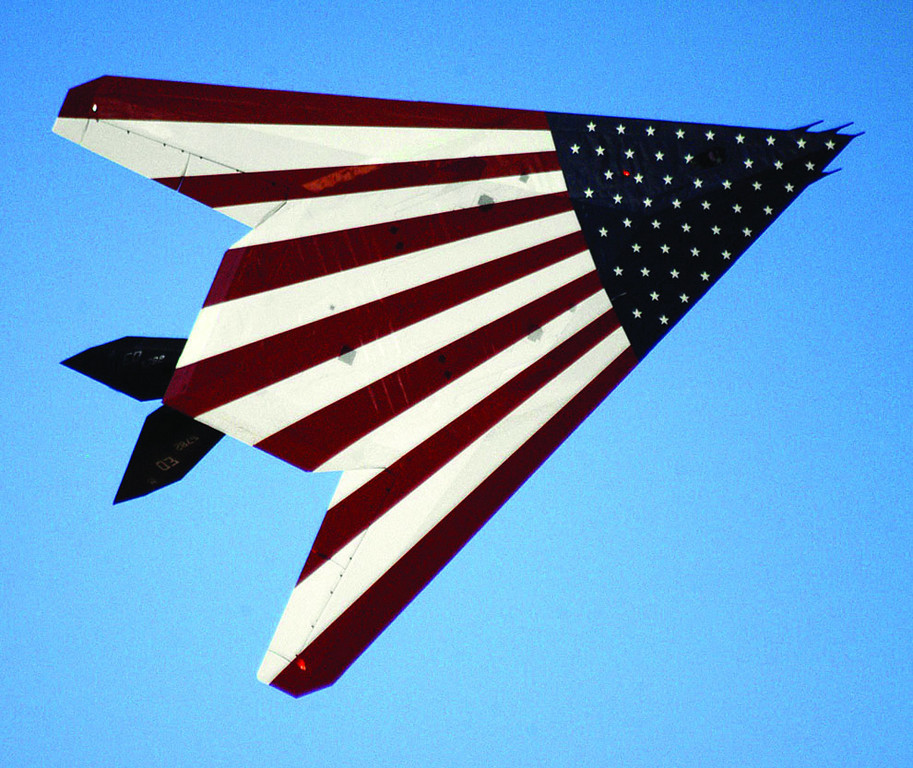 EDWARDS AIR FORCE BASE, Calif. -- With the American flag emblazoned on its underbelly, the F-117 Nighthawk with tail number 782 flies past spectators at the 2005 Edwards Open House and Air Show. About 120,000 people attended the event Oct. 22. This stealth fighter, the oldest of five prototypes, was hand made before full production of the aircraft started. (U.S. Air Force photo by Senior Airman Jet Fabara)