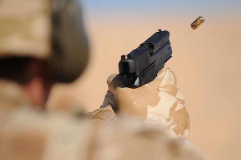 A member of the BRF fires his Sig Sauer pistol during a range package, the ejected case can be seen leaving the weapon.<br /> <br /> Soldiers from 4 Mechanised Brigade's Brigade Reconnaissance Force (4 Bde BRF) took part in Exercise Jordan Express.  The exercise in the south of Jordan was based in the desert and was intended to prepare the BRF in readiness for a future deployment to Afghanistan.<br />  <br /> Over 120 troops took part in the exercise which lasted approximately 4 weeks and involved various Mission Specific Training (MST) in readiness for their deployment in 2010.  <br /> <br /> The arduous and demanding exercise involved several range packages, mines awareness training, physical training, reconnaissance training and signals training, as well as more conventional infantry training.