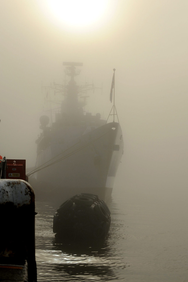 Picture shows the Type 22 frigate HMS Cornwall berthed at Portsmouth, UK in thick fog on a cold winters day. The ship had just returned from an eight month deployment on Anti-Piracy duties off the coast of Somalia, Africa.