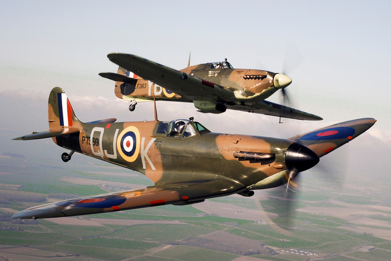 Spitfire P7350 (front) flies alongside Hurricane LF363 (back). P7350 (Mk IIa) is the oldest airworthy Spitfire in the world and the only Spitfire still flying to have actually fought in the Battle of Britain. LF363 (Mk IIC) was the last Hurricane to enter service with the RAF. <br /> <br /> The aircraft currently wears the colours of Hurricane Mk 1 P3878 'YB-W', the aircraft of Flying Officer Harold Bird-Wilson of No 17 Sqn during the Battle of Britain.