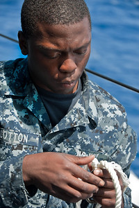 100707-N-0260R-007  PEARL HARBOR, Hawaii (July 7, 2010) - Boatswain's Mate Seaman Tyrone Cotton splices line together while doing routine maintenance aboard USS McClusky (FFG 41). McClusky is underway for Rim of the Pacific (RIMPAC) 2010, a biennial international military exercise involving naval units from 14 countries and is designed to strengthen regional partnerships and improve multinational interoperability.  This year marks the 22nd occurrence of the exercise   U.S. Navy Photo by Mass Communication Specialist 1st Class Brandon Raile.  (RELEASED)
