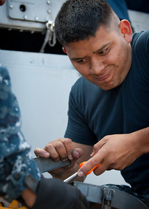 100707-N-0260R-004 PEARL HARBOR, Hawaii (July 7, 2010) - Aboard the USS McClusky (FFG 41), Fire Controlman 1st Class Pedro Jacinto works on one of the ship's Close In Weapons Systems (CIWS) while underway for Rim of the Pacific (RIMPAC) 2010.  RIMPAC is a biennial international military exercise involving naval units from 14 countries and is designed to strengthen regional partnerships and improve multinational interoperability.  This year marks the 22nd occurrence of the exercise   U.S. Navy Photo by Mass Communication Specialist 1st Class Brandon Raile.  (RELEASED)