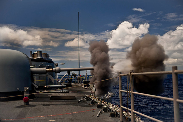 100712-N-0260R-001  PACIFIC OCEAN (July 12, 2010) - The Oliver Hazard Perry-class guided-missile frigate USS McClusky (FFG 41) fires it's 76mm deck gun during a live fire exercise as part of Rim of the Pacific (RIMPAC) 2010.  RIMPAC is a biennial international military exercise involving naval units from 14 countries and is designed to strengthen regional partnerships and improve multinational interoperability.  This year marks the 22nd occurrence of the exercise   U.S. Navy Photo by Mass Communication Specialist 1st Class Brandon Raile.  (RELEASED)