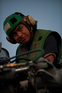 100709-N-0260R-071  PEARL HARBOR, Hawaii (July 9, 2010) - Aviation Electronics Airman Allen Tocaygomez pauses from conducting post flight checks to enjoy the sunset while underway aboard USS McClusky (FFG 41) during Rim of the Pacific (RIMPAC) 2010.  RIMPAC is a biennial international military exercise involving naval units from 14 countries and is designed to strengthen regional partnerships and improve multinational interoperability.  This year marks the 22nd occurrence of the exercise   U.S. Navy Photo by Mass Communication Specialist 1st Class Brandon Raile.  (RELEASED)