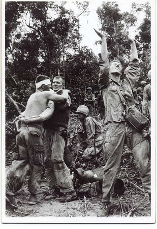 July 25, 1966, a picture that made a bunch of newspapers. Marty Morris reaching for the helo sling, Lynn Felton with the bandage on his head. Steve Fautch crouching in the background. Holding up Felton is an unidentified helo crew member