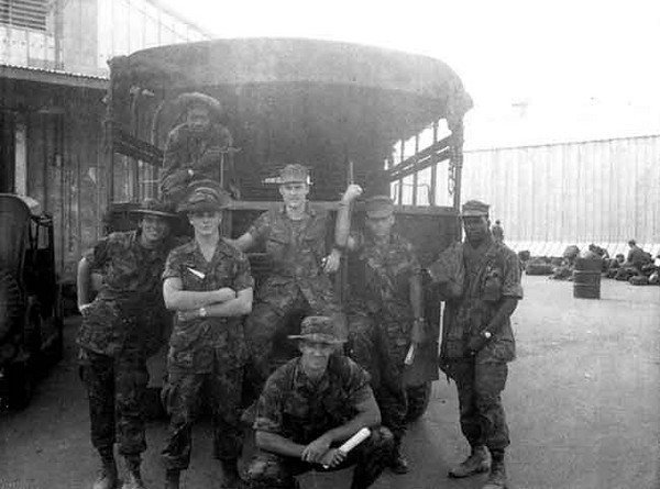 Kneeling is Bob Wunderlich; Standing left to right: Banyon Ford, unknown, Redsey, Ed Spoon, unknown; In truck is Grasshopper