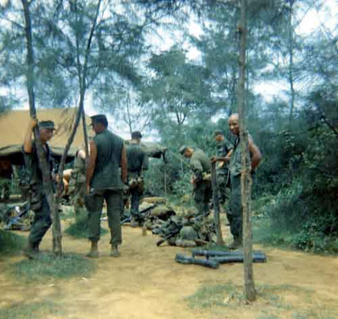 3rd Platoon, 1967-68. Standing left with right hand on tree is Corporal Boots. Middle facing away is Lt. Duckworth, on far right is Corporal Smith (Smitty) with right hand on a 3.5 rocket launcher tube.