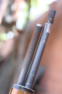 This is before being cleaned,  Notice the rust and corrosion on the threads at the end of the rifle barrel.  And again, the outside of the rifle barrel itself is in good condition.