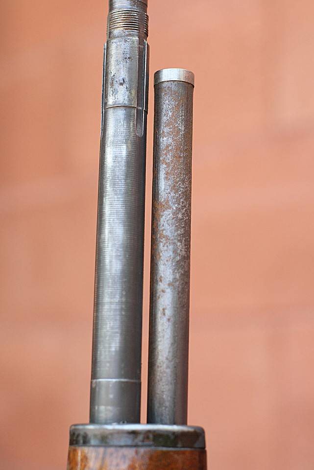 Close-up after they have been wiped clean.  You can still see the corrosion on the receiving rod and barrel tip.   The barrel adjacent to the receiving rod is in excellent condition.