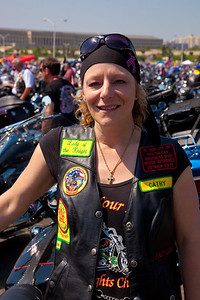 Cathleen of the Nam Nights group poses next to her bike. Rolling Thunder assembles at the Pentagon parking lot on the morning of May 30, 2010 on Memorial Day Weekend Thousands of motorcycles later ride through Washington in an annual demonstration seeking to improve veteran benefits and resolve POW/MIA issues.  Rolling Thunder has evolved to be not only a demonstration for the POW/MIA issue but also a demonstration of patriotism and respect for soldiers and veterans from all wars. (Photo by Jeff Malet)
