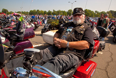 Alain Piche of Montreal Canada relaxes on his motorcycle. Rolling Thunder assembles at the Pentagon parking lot on the morning of May 30, 2010 on Memorial Day Weekend Thousands of motorcycles later ride through Washington in an annual demonstration seeking to improve veteran benefits and resolve POW/MIA issues.  Rolling Thunder has evolved to be not only a demonstration for the POW/MIA issue but also a demonstration of patriotism and respect for soldiers and veterans from all wars. (Photo by Jeff Malet)