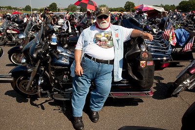 J. Hayes from Hyattsville MD relaxes in front of his bike. Rolling Thunder assembles at the Pentagon parking lot on the morning of May 30, 2010 on Memorial Day Weekend Thousands of motorcycles later ride through Washington in an annual demonstration seeking to improve veteran benefits and resolve POW/MIA issues.  Rolling Thunder has evolved to be not only a demonstration for the POW/MIA issue but also a demonstration of patriotism and respect for soldiers and veterans from all wars. (Photo by Jeff Malet)