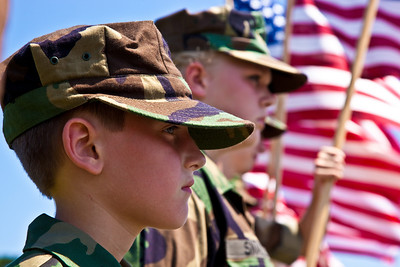 Members of the Young Marines line the street with flags in Arlington. On the morning of May 30, 2010 on Memorial Day Weekend Thousands of Rolling Thunder motorcycles ride through Washington DC in an annual demonstration seeking to improve veteran benefits and resolve POW/MIA issues.  Rolling Thunder has evolved to be not only a demonstration for the POW/MIA issue but also a demonstration of patriotism and respect for soldiers and veterans from all wars. (Photo by Jeff Malet)