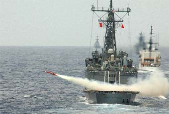 Launching of a missile from an Oliver Hazard Perry class guided missile frigate.
