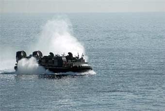The Landing Craft, Air Cushion (LCAC) is a heavy lift, high speed, over the horizon air cushion landing craft.