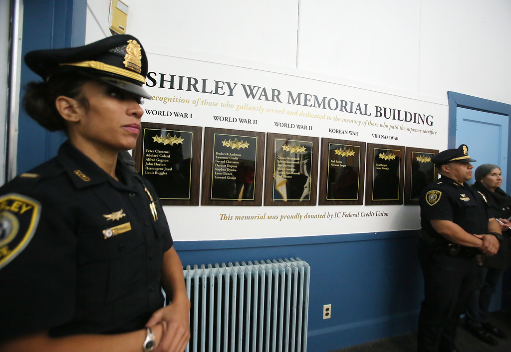 . Shirley Police Lt. Alfreda Cromwell, left, and Police Chief Sam Santiago, at dedication of plaques to Shirley war dead, at the War Memorial Building in Shirley. I.C. Federal Credit Union funded the plaques, which include an empty plaque in the unfortunate event of future casualties. (SUN/Julia Malakie)