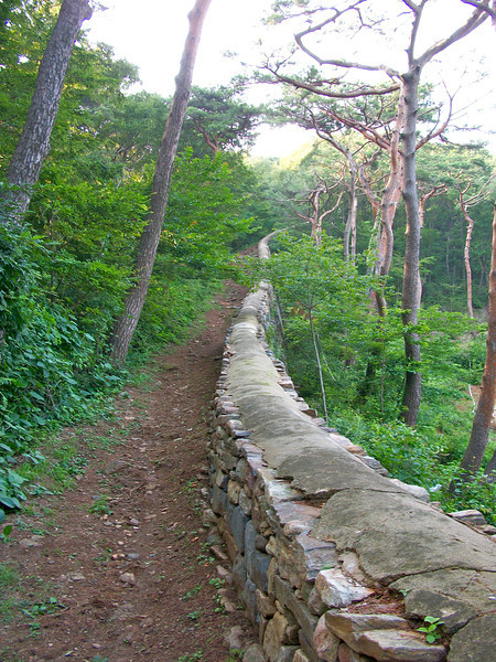 wall of the fortress, Samrangseong, surrounding the temple which supposedly repelled an invading French nave in 1866.