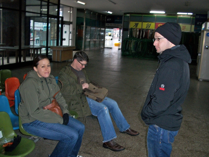 Kate, Kris, and Boris waiting in the cold Song Tan bus terminal for Julius to arrive.