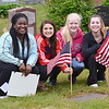Rachel Twerefour, Allie Pandiscio, Sarah Cormier, and Makenzie Thomas, all part of Leominster High's Legacy Project, place flags on the graves of veterans at St. Leo's Cemetery in Leominster on Saturday morning. SENTINEL & ENTERPRISE / Ashley Green