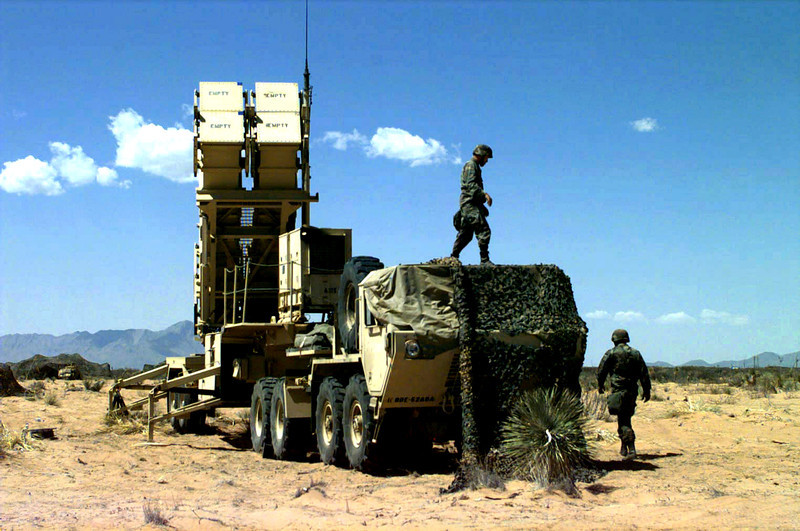 US Army Specialist (SPC) Guerra and Private First Class (PFC) Sabree, A Battery, 5th Battalion,  52nd Air Defense Artillery, 11th ADA Brigade, prepare a four canister launcher, on an M-109 trailer,  for an MIM-104 Patriot Missile Launch Drill at Base Camp McGregor Missile Range, Fort Bliss, Texas, during Exercise ROVING SANDS '97, 15 April 1997.