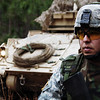 U.S. Army Sgt. Ariel Rodriguez, 413th Civil Affairs Battalion, Texas Army Reserve, stands guard in front of a M2A3 Bradley Fighting Vehicle (BFV) while Soldiers from the 3rd Infantry Division conduct a cordon and search of the mock city of Al-Faraola on March 1, 2007, at Fort Stewart, Ga., during the 3rd Infantry Division Mission Readiness Exercise.  (U.S. Army photo by Spec. Nicholaus Wiliams) (Released)
