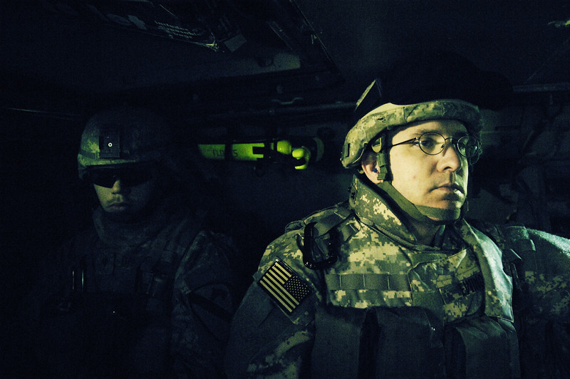 U.S. Air Force Master Sgt. Thomas Ewing, 732nd Expeditionary Support Squadron, rides in an M1A3 Bradley Fighting Vehicle while on patrol with the U.S. Army, Bravo Company, 1st Cavalry Division, 12th Infantry Regiment, in Buhriz, Iraq, on Feb. 17, 2007.  (U.S. Air Force photo by Staff Sgt. Stacy L. Pearsall) (Released)
