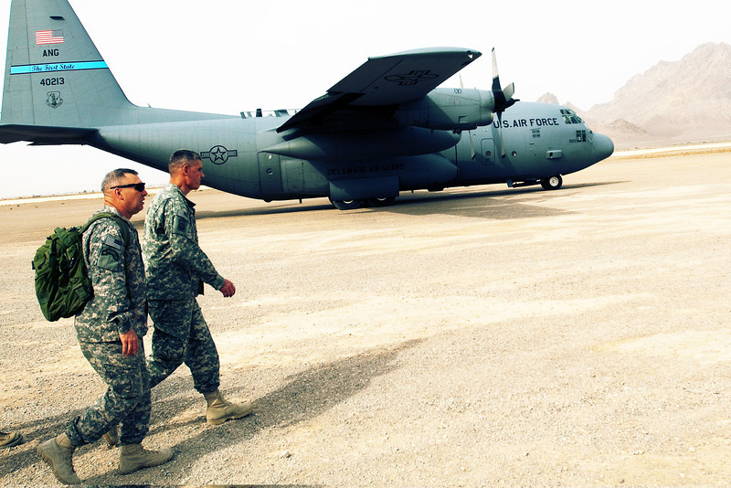 U.S. Army Command Sgt. Maj. Darrin Bohn, left, the senior enlisted advsior to International Security Assistance Force (ISAF) Joint Command, and ISAF Joint Command commander Lt. Gen. David Rodriguez, walk past a U.S. Air Force C-130 Hercules at Camp Sayer, in Farah province, Afghanistan, April 27, 2011.  (U.S. Army photo by Staff Sgt. Brandon Pomrenke/Released)