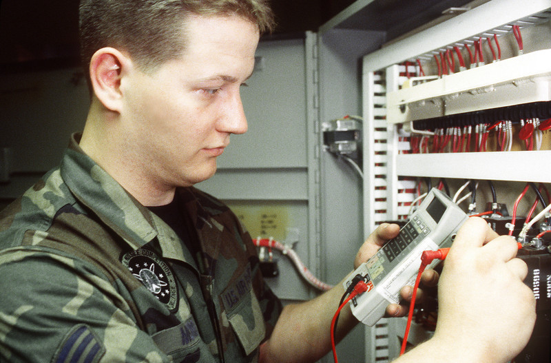 Senior Airman Matthew Morris, a facility maintenance team member belonging to the 448th Missile  Squadron at  Grand Forks, AFB, N.D., takes a voltage reading on a circuit breaker that supplies power to a launch control capsule.