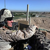 U.S. Marine Corps Cpl. John Lamecker responds to a call over the radio during an overwatch mission at Combat Outpost Ouellette in Helmand province, Afghanistan, April 22, 2011. The communications chief with Delta Company, 1st Tank Battalion, 1st Marine Regiment, kept track of all the communications equipment for the unit. (U.S. Marine Corps photo by Cpl. Marco Mancha/Released)
