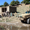 Afghan children sit near an RG-31 mine-resistant, ambush-protected vehicle outside the Terezayi bazaar near Combat Outpost Terezayi in Khost province, Afghanistan, April 17, 2011. (U.S. Army photo by Pfc. Donald Watkins/Released)
