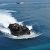 An amphibious assault vehicle approaches the dock landing ship USS Tortuga (LSD 46) after an exercise for Cooperation Afloat Readiness and Training (CARAT) 2011 in the South China Sea June 12, 2011. CARAT is a series of bilateral exercises held annually in Southeast Asia to strengthen relationships and enhance force readiness. (U.S. Navy photo by Mass Communication Specialist 2nd Class Katerine Noll/Released)