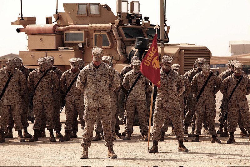 U.S. Marines and Sailors bow their heads during the chaplain's invocation during a transfer of authority ceremony at Camp Leatherneck in Helmand province, Afghanistan, March 27, 2011. The ceremony transferred operational responsibilities from Marine Wing Support Squadron (MWSS) 373 to MWSS-272, 2nd Marine Aircraft Wing (Forward) in support of Regional Command Southwest. (U.S. Marine Corps photo by Lance Cpl. Samantha H. Arrington/Released)