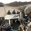 California Army National Guard Soldiers from Bravo Company, 1st Battalion, 185th Armor, 81st Armor Brigade, prepare for an upcoming area reconnaissance on Sept. 6, 2004 around Balad, Iraq during Operation Iraqi Freedom. One Soldier sets the Single Channel Ground and Airborne Radio System atop a High-Mobility Multipurpose Wheeled Vehicle while an M1A1 Abrams Main Battle Tank provides cover in the background. The area recon is to deny anti-Iraqi forces the freedom to operate and move throughout the countryside.  (U.S. Air Force photo by Staff Sergeant Shane A. Cuomo) (Released).