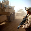 U.S. Marine Corps Staff Sgt. Maximo Veliz provides security for his fellow Marines as they park mine-resistant, ambush-protected (MRAP) vehicles at the district of Marjah, Afghanistan, April 3, 2011. Veliz is the noncommissioned officer in charge of Personal Security Detachment, 3rd Battalion, 9th Marine Regiment. (U.S. Marine Corps photo by Cpl. Marco Mancha/Released)