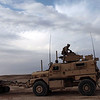 U.S. Marine Corps Lance Cpl. Yair Mendoza, an anti-armor missileman with Combined Anti-Armor Team 1, Weapons Company, 3rd Battalion, 5th (3/5) Marine Regiment, Regimental Combat Team (RCT) 8, climbs in to a mine-resistant, ambush-protected vehicle turret as Marines conduct a vehicle checkpoint during Apache Rage in Sangin, Helmand province, Afghanistan, Feb. 19, 2011. Apache Rage was an operation to gain atmospherics on villages in the Sangin district. The battalion was a combat element of RCT-8, which conducted counterinsurgency operations in partnership with the International Security Assistance Force in Afghanistan. (U.S. Marine Corps photo by Cpl. David Hernandez /Released)