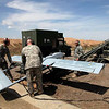 U.S. Army Sgt. 1st Class Chris Devoss, Sgt. Michael Prince, and Sgt. Joshua Mackay prepare to launch an RQ-7B Shadow unmanned aerial vehicle at Contingency Operating Site Warrior, Iraq, April 6, 2011. The Soldiers are assigned to Company A, Special Troops Battalion, 1st Advise and Assist Task Force, 1st Infantry Division. (U.S. Army photo by Spc. Sara Wakai/Released)