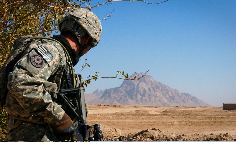 U.S. Army Staff Sgt. Christopher M. Picache, with 3rd Platoon, Hawk Company, 3rd Battalion, 2nd Stryker Cavalry Regiment, scans an open area for threats during a patrol in Maiwand district, Kandahar province, Afghanistan, Nov. 24, 2010. (U.S. Army photo by Spc. Edward A. Garibay/Released)