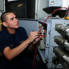 U.S. Navy Electrician's Mate Fireman Chris Eisenhauer monitors the power supply for catapult 2 on the aircraft carrier USS Ronald Reagan (CVN 76) while the ship is under way in the Pacific Ocean March 7, 2011. (U.S. Navy photo by Mass Communication Specialist 2nd Class Josh Cassatt/Released)