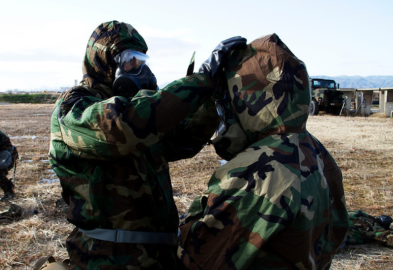U.S. Marines help each other put on chemical, biological, radiological, nuclear (CBRN) hazard protection gear as part of a CBRN hazard scenario during Active Shield 2011 at Marine Corps Air Station Iwakuni, Japan, March 2, 2011. Active Shield is a combined anti-terrorism training exercise intended to strengthen cooperation between U.S. and Japanese forces in the Iwakuni-Hiroshima region and prepare Japanese forces to guard U.S. facilities if needed. (U.S. Marine Corps photo by Cpl. Andrea M. Olguin/Released)