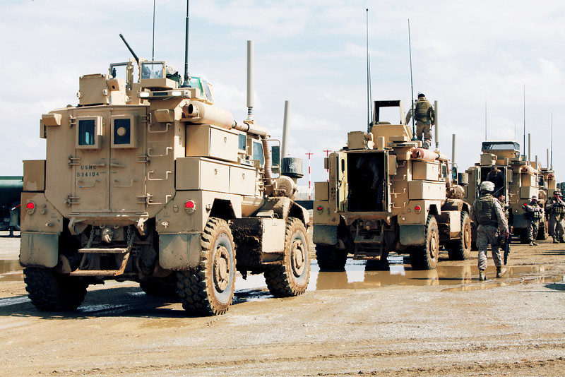 A convoy of U.S. Marine Corps mine-resistant, ambush-protected vehicles drives down a road near Camp Leatherneck, Afghanistan, March 5, 2011. More than 50 Marines assigned to Marine Wing Support Squadron 373 returned to Camp Leatherneck after completing an independent convoy to Camp Dwyer, Afghanistan. (U.S. Marine Corps photo by Lance Cpl. Samantha H. Arrington/Released)