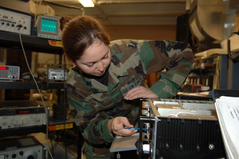 U.S. Air Force Airman 1st Class Jade Abudia, an airfield system technician from 28th Communications Squadron, aligns a power supply and audio filter amplifier/detector card to a radio transmitter at Ellsworth Air Force Base, S.D., Feb. 20, 2007. (U.S. Air Force photo by Airman 1st Class Angela Ruiz) (Released)