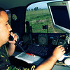 Romanian Army Cpl. Adrian Coman, Radio Operator, 89th Main Communications Center, completes a transmission test in the mobile communications vehicle on May 14, 2005, at Mihail Kogalniceanu Airfield, Romania.  A 2001 Chevy Tahoe SUV, assigned to the Romanian Army is outfitted with the Falcon II RF-5800H multiband tactical radio system.  The Falcon II is a reliable way to send High Frequency VHF-FM tactical communications through enhanced secure voice and data.  Combined Endeavor 2005, held from May 13th through the 26th, is a U.S. European command-sponsored exercise, designed to identify and document command, control, communications, and computer (C4) interoperability between NATO and Partnership for Peace nations.  Representatives from 43 countries and NATO are taking part in the exercise.  (U.S. Air Force Photo by Tech. Sgt. Andrew Rodier) (Released)
